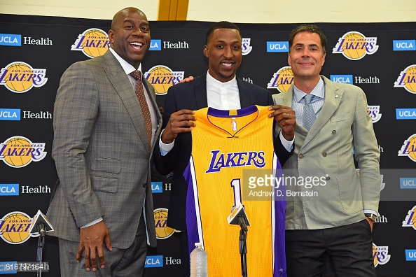 Magic Johnson & Mitch Kupchak with free-agency pick up Kentavious Caldwell-Pope. Photo; Andrew D. Bernstein