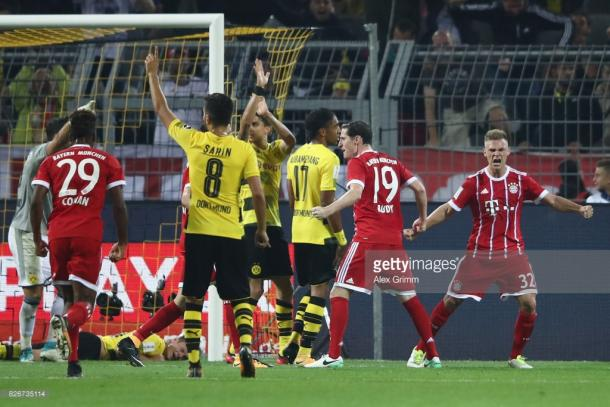 Kimmich (right) celebrates his key role in the late equaliser. | Photo: Getty/Alex Grimm/Bongarts.