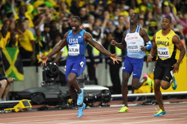 Gatlin celebrates crossing the line to take the world title (Getty/Shaun Botterill)