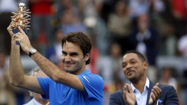 Federer, con Will Smith como testigo, en el 2012 | Foto: zimbio