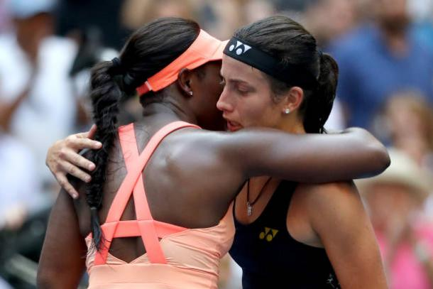 Stephens and Sevastova embrace after their match (Getty/Abbie Parr)