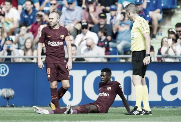 Momento em que Dembélé sentiu a lesão   Foto: Denis Doyle/Getty Images