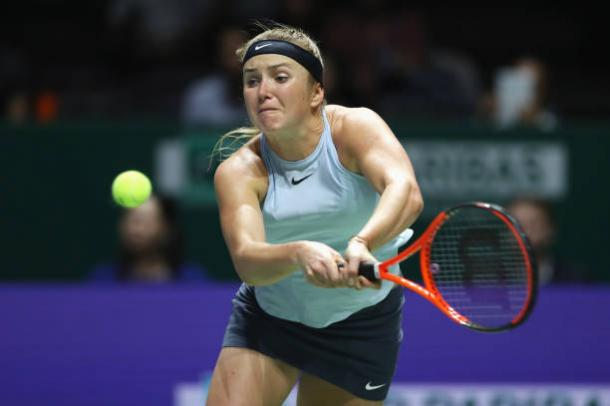 WTA finals: Wozniacki beats Halep to reach semis