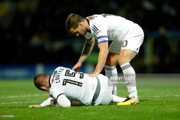The reverse fixture was marred by an injury to Blades midfielder Paul Coutts. (picture: Getty Images / Malcolm Cousins)