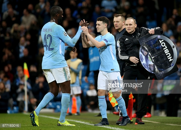 MANCHESTER, ENGLAND - NOVEMBER 21: Yaya Toure of Manchester City and Phil Foden of Manchester City shake hands when Phil Foden of Manchester City is being substituted during the UEFA Champions League group F match between Manchester City and Feyenoord at Etihad Stadium on November 21, 2017 in Manchester, United Kingdom. (Photo by Tom Flathers/Man City via Getty Images)