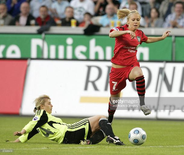 FCR 2001 Duisburg's Turid Knaak (R) and Zvezda-2005's Alla Lyshafay vies for the ball during the UEFA Women's Cup in the western German city of Duisburg on May 22, 2009. The second-leg match ended in a 1-1 after Duisburg won the first-leg 6-0.AFP PHOTO DDP / JUERGEN SCHWARZ GERMANY OUT (Photo credit should read JUERGEN SCHWARZ/AFP/Getty Images)