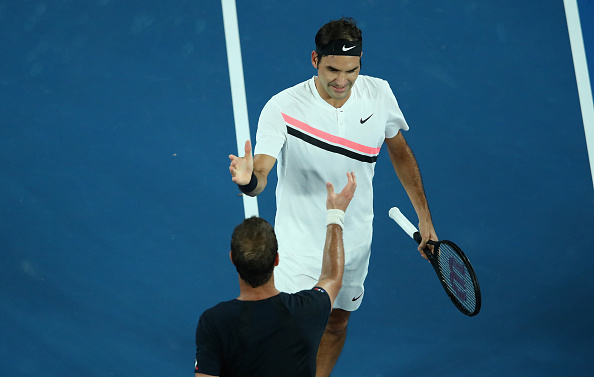 Roger Federer and Richard Gasquet shake hands at the net (Photo: Quinn Rooney/Getty Images)