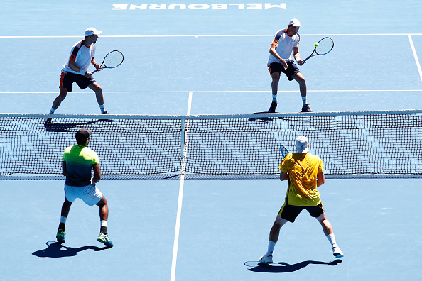 Bob and Mike Bryan compete in their quarterfinal match against Marcin Matkowski and Aisam-ul-Haq Qureshi (Photo: Michael Dodge/Getty Images)
