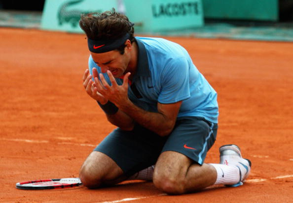 An extremely emotional yet overjoyed Federer falls to the ground as he wins the French Open in 2009. Credit: Ryan Pierse/Getty Images