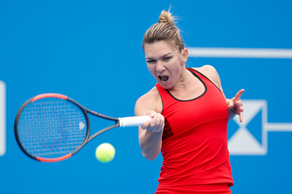 Simona Halep in action during her second-round match against Duan Ying-ying | Photo: Wu Zhizhao / Getty Images AsiaPac