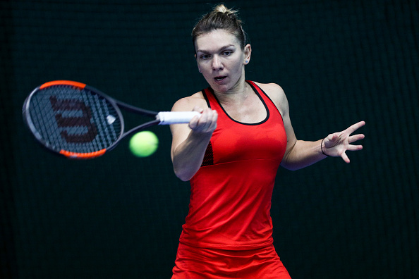 Simona Halep in action during the final | Photo: Zhong Zhi / Getty Images AsiaPac