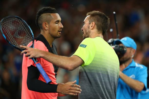 Kyrgios and Troicki meet following the end of their match (Getty/Clive Brunskill)