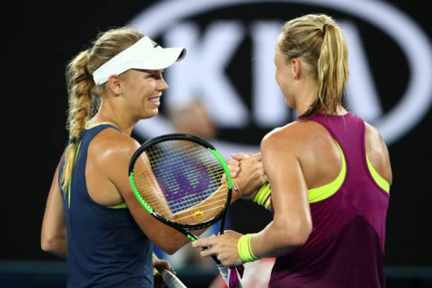 Wozniacki and Bertens meet at the net after a competitive third round clash (Getty/Cameron Spencer)