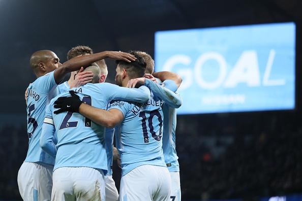 Jogadores comemoram gol de Agüero (Foto: Matthew Ashton - AMA/Getty Images)