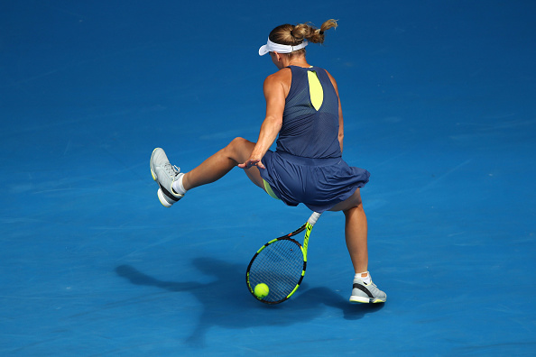 Caroline Wozniacki hits a tweener during her fourth round match of the Australian Open. (Photo: Getty Images/Clive Brunskill)