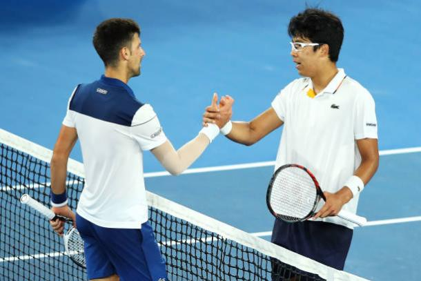 Djokovic and Chung meet at the net following the conclusion of the match (Getty/Mark Kolbe)