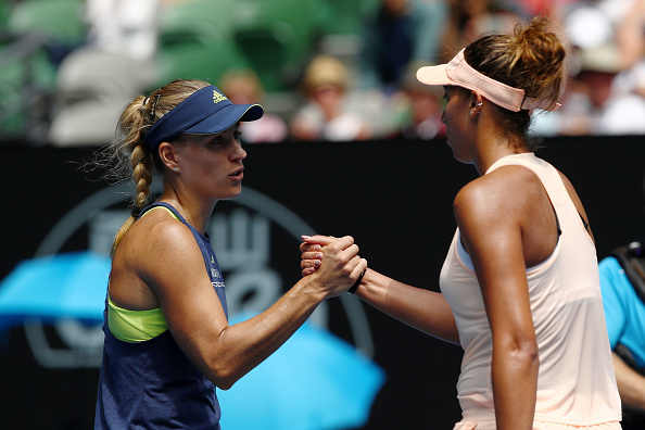 Angelique Kerber (L) shakes hands with Madison Keys (R) after their quarterfinal match at the Australian Open. (Photo: Getty Images/Clive Brunskill)