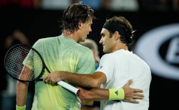 Berdych and Federer meet following the conclusion of the match (Getty/XIN LI)