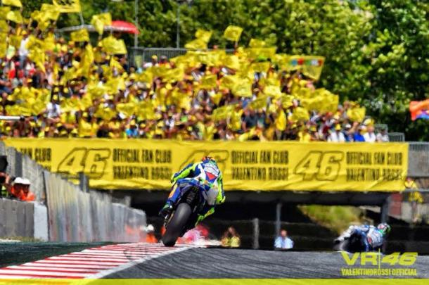 Rossi riding in front of a seas of his yellow VR46 fans in Misano last year - www.vr46.com