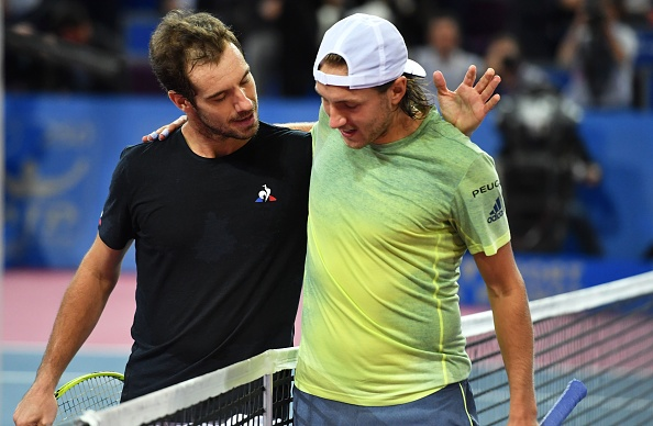 Richard Gasquet congratulates Lucas Pouille on his win (Photo: Pascal Guyot/Getty Images)