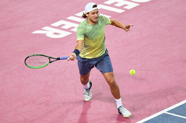 Lucas Pouille strikes a forehand (Photo: Pascal Guyot/Getty Images)