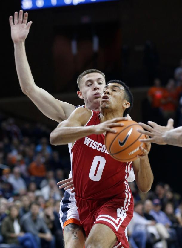 Trice and the Badgers were suffocated by Virginia's defense all night/Photo: Steve Helber/Associated Press