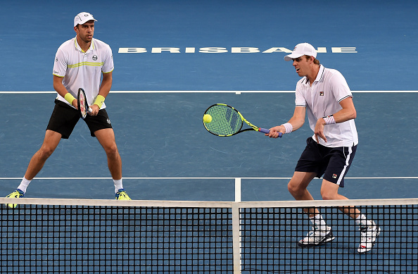 Gilles Muller and Sam Querrey in action the last time they partnered one another (Photo: Saeed Khan/Getty Images)
