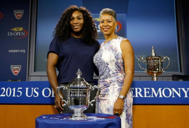Adams poses with Serena at the 2015 U.S. Open draw ceremony. Credit: Kathy Willens, STF / Associated Press