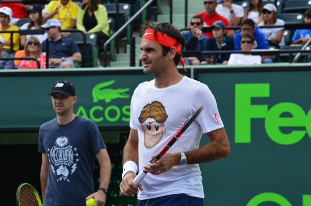 Federer, sporting his new Nike Emoji T-shirt, warms up before the tournament in front of fans. Credit: Miami Open