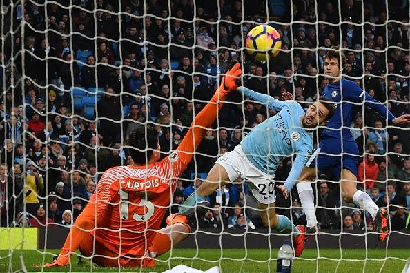 Courtois não consegue evitar o gol de Bernardo Silva (Foto: Anthony Devlin/AFP)