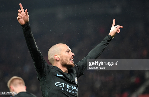 STOKE ON TRENT, ENGLAND - MARCH 12: David Silva of Manchester City celebrates as he scores their second goal during the Premier League match between Stoke City and Manchester City at Bet365 Stadium on March 12, 2018 in Stoke on Trent, England. (Photo by Michael Regan/Getty Images)