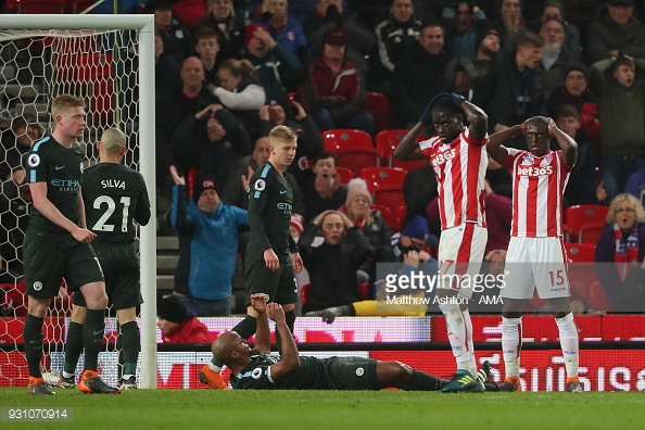 STOKE ON TRENT, ENGLAND - MARCH 12: Bruno Martins Indi of Stoke City and Badou Ndiaye of Stoke City react to a good chance being sent over the crossbar during the Premier League match between Stoke City and Manchester City at Bet365 Stadium on March 12, 2018 in Stoke on Trent, England. (Photo by Matthew Ashton - AMA/Getty Images)