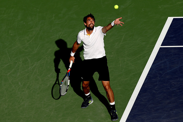 Jeremy Chardy gearing up to serve (Photo: Matthew Stockman/Getty Images)
