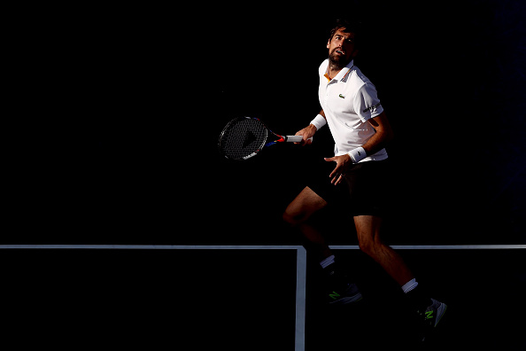 Jeremy Chardy ready to play an overhead shot (Photo: Matthew Stockman/Getty Images)
