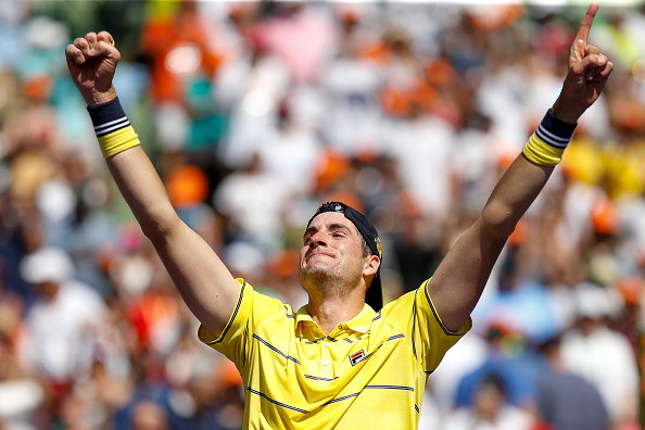 John Isner celebrates putting away championship point (Photo: Michael Reaves/Getty Images)