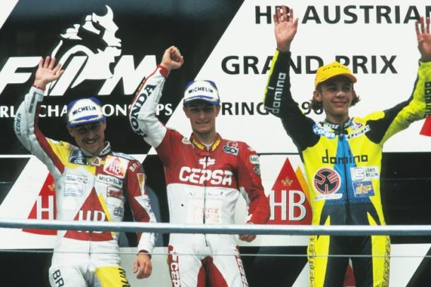 A very young Rossi claiming third on the podium after the 1996 Austrian 125cc race - www.speedweek.com
