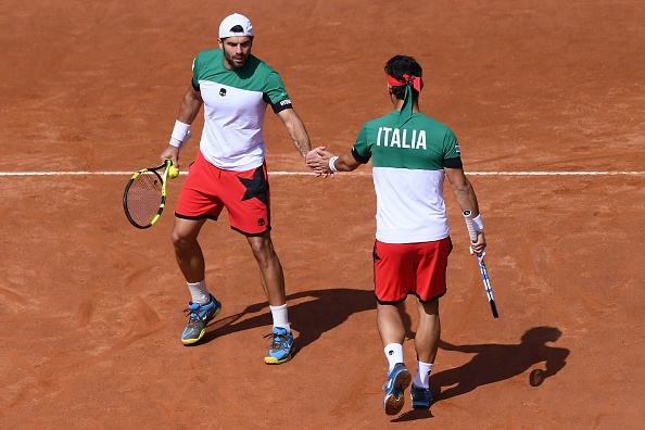 Simone Bolelli and Fabio Fognini shake hands in between points (Photo: Marco Bertorelli/Getty Images)