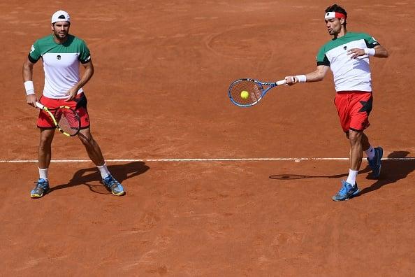 Fabio Fognini plays a return with Simone Bolelli (Photo: Marco Bertorello/Getty Images)