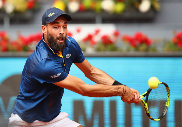 Benoit Paire reaches for a backhand shot (Photo: Clive Brunskill/Getty Images)