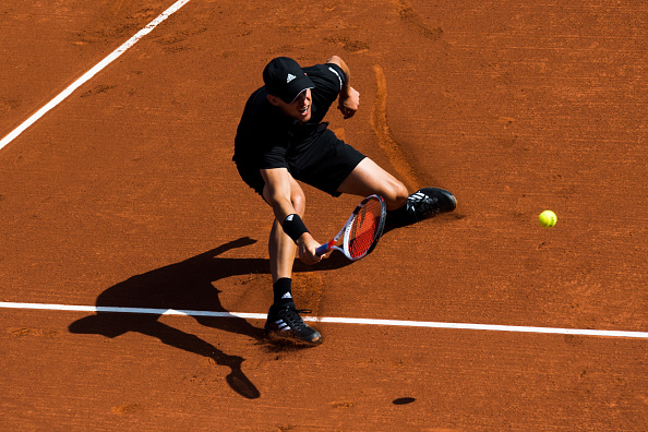 Dominic Thiem plays a forehand shot (Photo: Alex Caparros/Getty Images)