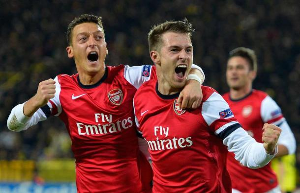 Ramsey and Ozil celebrate in Dortmund. Source: givemesport.com