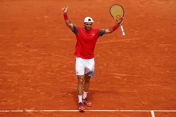 Malek Jaziri celebrates winning the second set (Photo: Cameron Spencer/Getty Images)