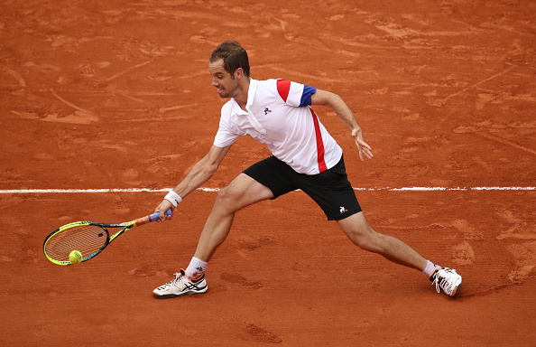 Richard Gasquet chases down a shot (Photo: Cameron Spencer/Getty Images)