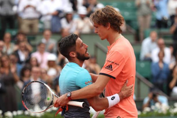 Dzumhur and Zverev embrace following the thrilling encounter (Getty/Matthew Stockman)