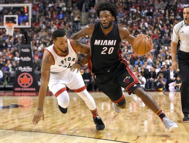 Miami Heat forward Justise Winslow (20) dribbles the ball past Toronto Raptors guard Norman Powell (24) |Dan Hamilton-USA TODAY Sports|