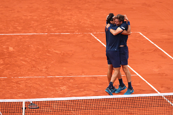 Pierre-Hugues Herbert and Nico Mahut celebrate winning the French Open title (Photo: Clive Brunskill/Getty Images)