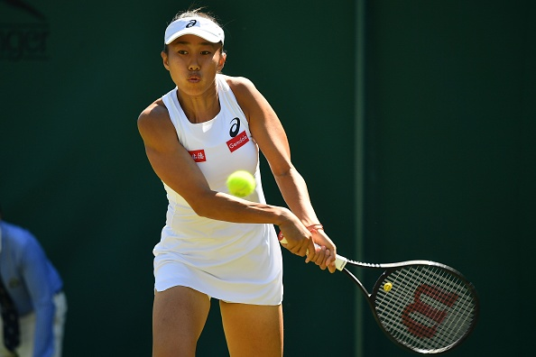 Zhang gets back into the match after taking the second set | Photo: Ben Stansall/Getty Images