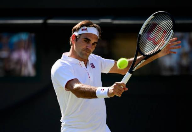 Federer in action during his quarterfinal loss at Wimbledon this year (Getty/TPN)
