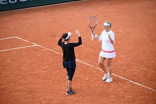Guarachi (right), seen here with Krawcyzk after their semifinal win, is the first Chilean woman in a Grand Slam final in over 80 years. Photo: