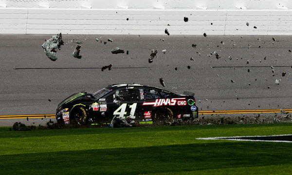 Kurt Busch spins into the grass. (Jonathan Ferrey/Getty Images North America)
